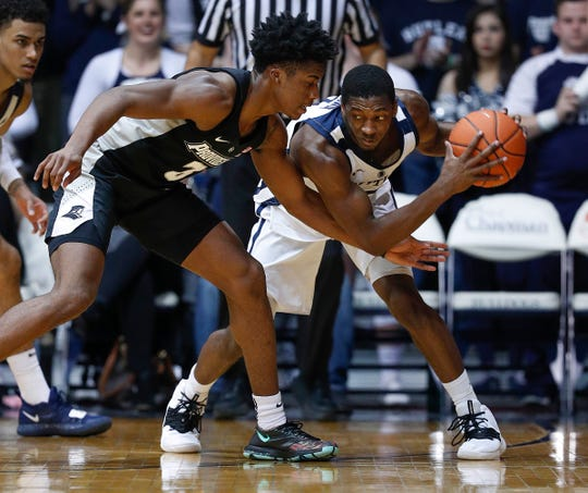 Butler Bulldogs guard Kamar Baldwin (3) keeps the ball away from Providence Friars guard David Duke (3) in the second half of their game at Hinkle Fieldhouse on Tuesday, Feb 26, 2019. The Butler Bulldogs lost in overtime to the Providence Friars 73-67.