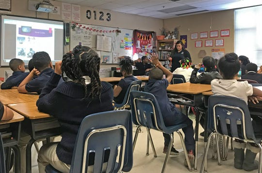 Katie Millikan is teaching her third-grade class at Avondale Meadows Academy Indianapolis about slavery on Feb. 20, 2019.
