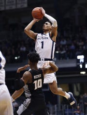 Butler Bulldogs forward Jordan Tucker (1) puts up a shot over Providence Friars guard A.J. Reeves (10) in the first half of their game at Hinkle Fieldhouse on Tuesday, Feb 26, 2019.