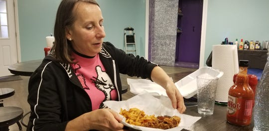 IndyStar food writer Liz Biro eats at Shani's Secret Chicken, a secret restaurant inside Chapati, a Pakistani restaurant off of Lafayette Road near Interstate 65 in Indianapolis on Feb. 13, 2019.