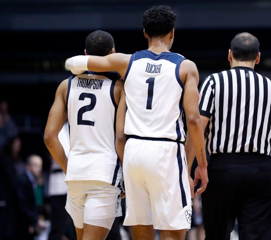 Butler Bulldogs forward Jordan Tucker (1) puts his arm around Aaron Thompson (2) in the final minutes of their game at Hinkle Fieldhouse on Tuesday, Feb 26, 2019. The Butler Bulldogs lost in overtime to the Providence Friars 73-67.