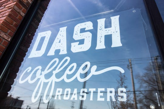 A banner hangs in the window at the future location of Dash Coffee on Wednesday, Feb. 27, 2019, along N. Linn Street in Iowa City's Northside District.