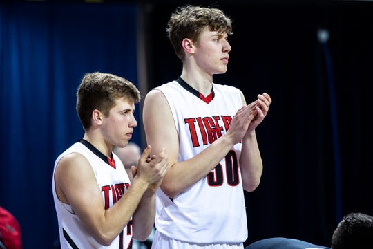 Cedar Falls' Chase Courbat, right, and Jaxon Heth cheer on their teammates during a Class 4A substate boys' basketball game on Tuesday, Feb. 26, 2019, at the U.S. Cellular Center in Cedar Rapids, Iowa.