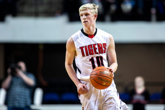 Cedar Falls' Logan Wolf (10) takes the ball up court during a Class 4A substate boys' basketball game on Tuesday, Feb. 26, 2019, at the U.S. Cellular Center in Cedar Rapids, Iowa.