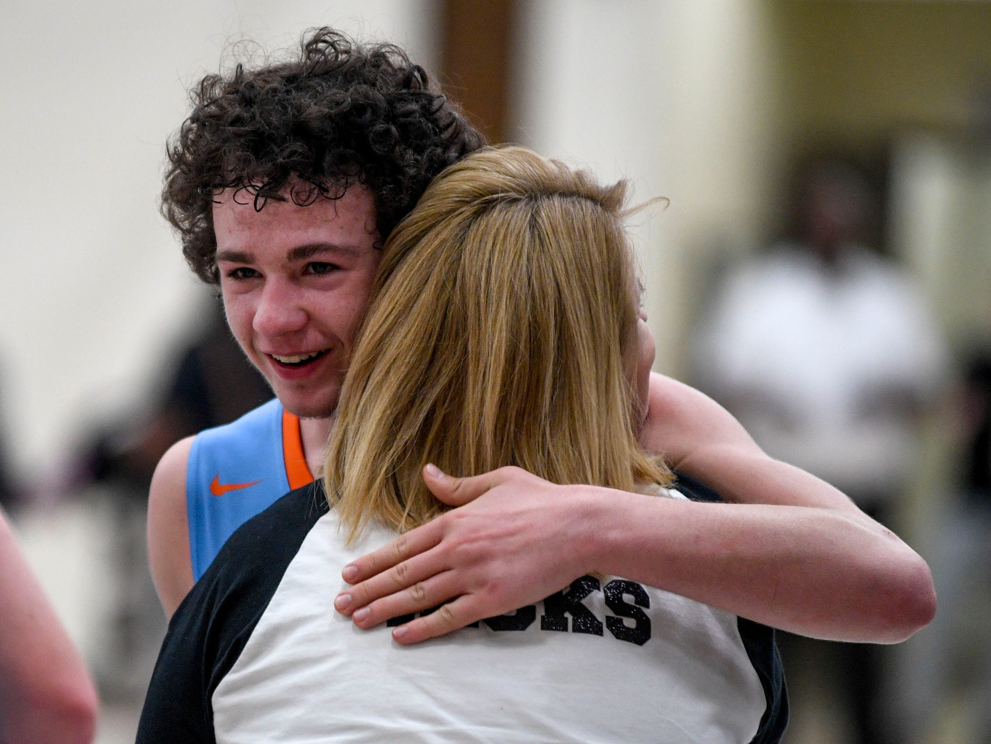 South Gibson's Caleb Pearce (3) is embraced after the buzzer goes off during the TSSAA Region 7-AA semifinal game between South Side and South Gibson after an upset result at Dyersburg High School, in Dyersburg, Tenn., on Tuesday, Feb. 26, 2019.