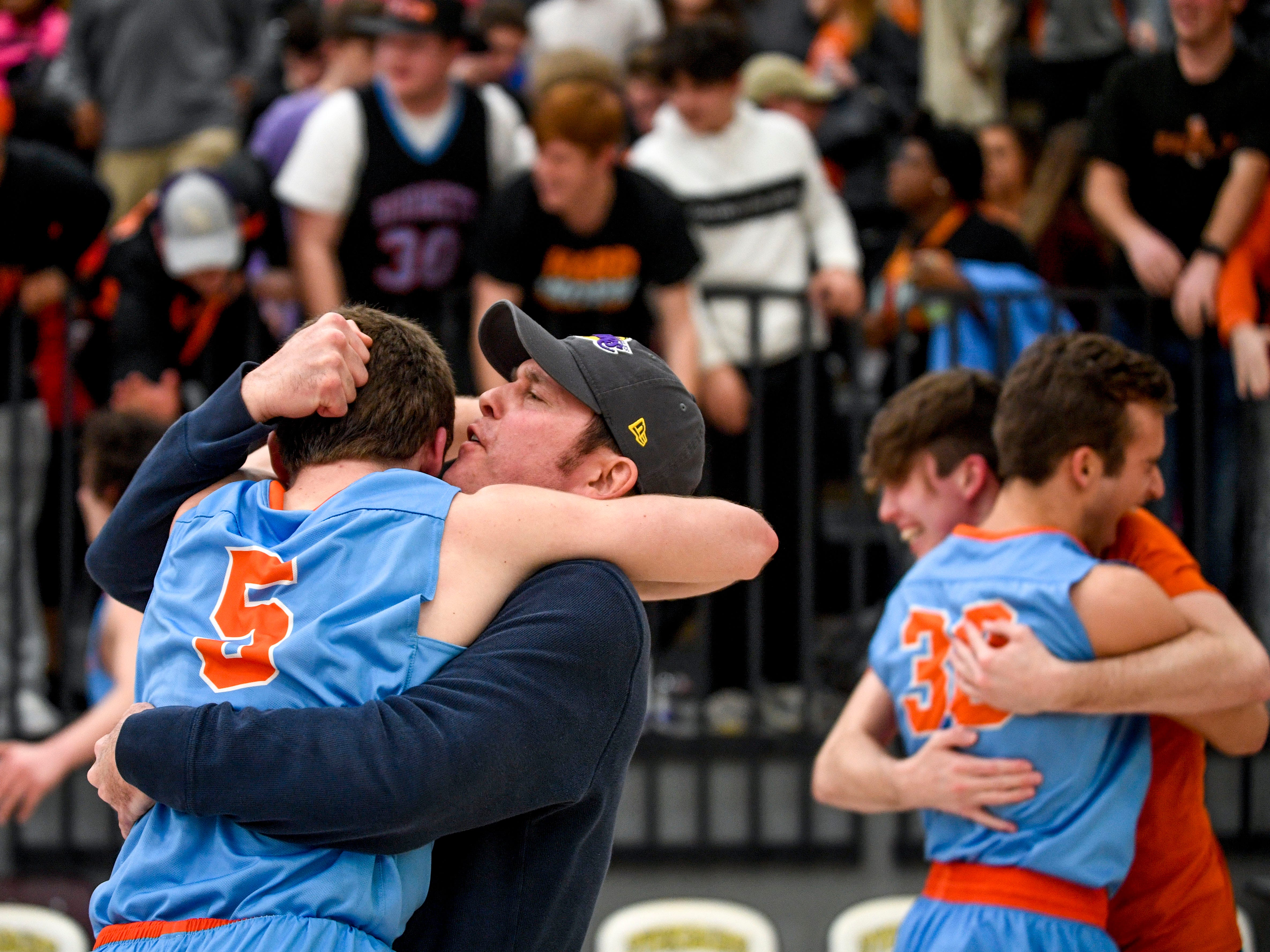 David Hicks whispers in his son's ear while celebrating with his son, Nathan Hicks (5) after the buzzer in the TSSAA Region 7-AA semifinal game between South Side and South Gibson after an upset result at Dyersburg High School, in Dyersburg, Tenn., on Tuesday, Feb. 26, 2019.