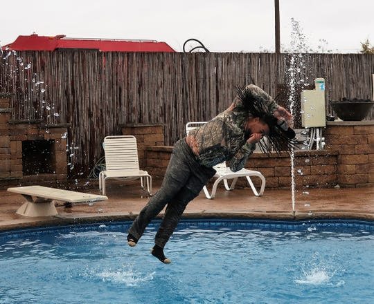"A member of the D & S Soldiers team took an icy ""plunge"" to benefit Special Olympics during the annual Polar Plunge ""Freezin' for a Reason"" event held at Aloha Pools and Spas on Saturday."
