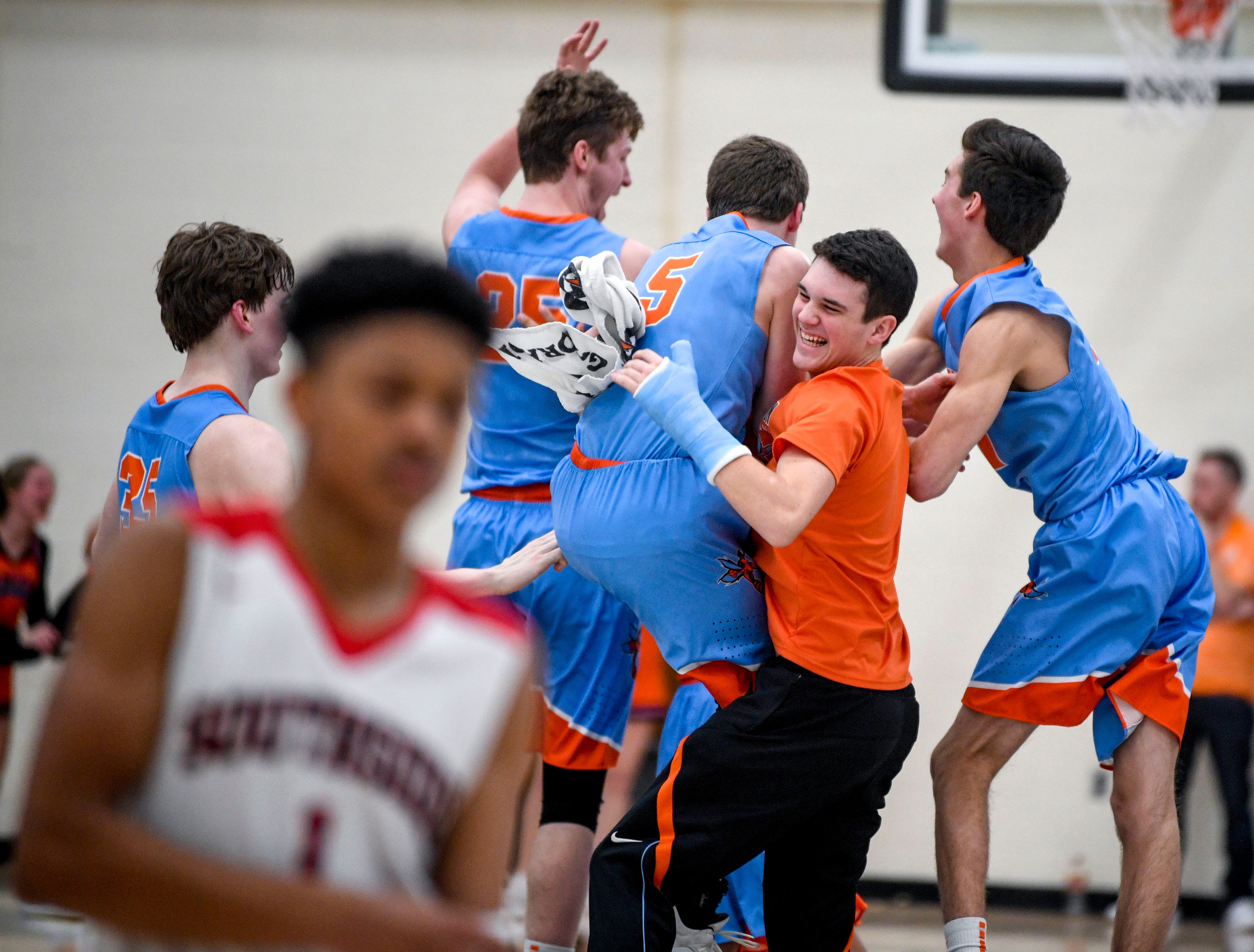 South Gibson players celebrate after the buzzer during the TSSAA Region 7-AA semifinal game between South Side and South Gibson after an upset result at Dyersburg High School, in Dyersburg, Tenn., on Tuesday, Feb. 26, 2019.