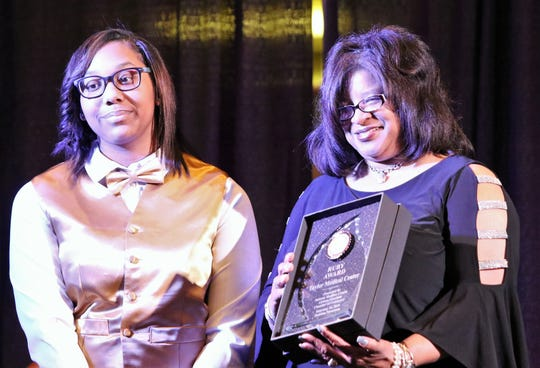 Michelle Taylor-Moragne accepted the Ruby Award on behalf of Taylor Medical Clinic during the 18th annual Jewel Awards Banquet sponsored by the Jackson-Madison County African-American Chamber of Commerce held at the Oman Arena in Jackson on Friday.