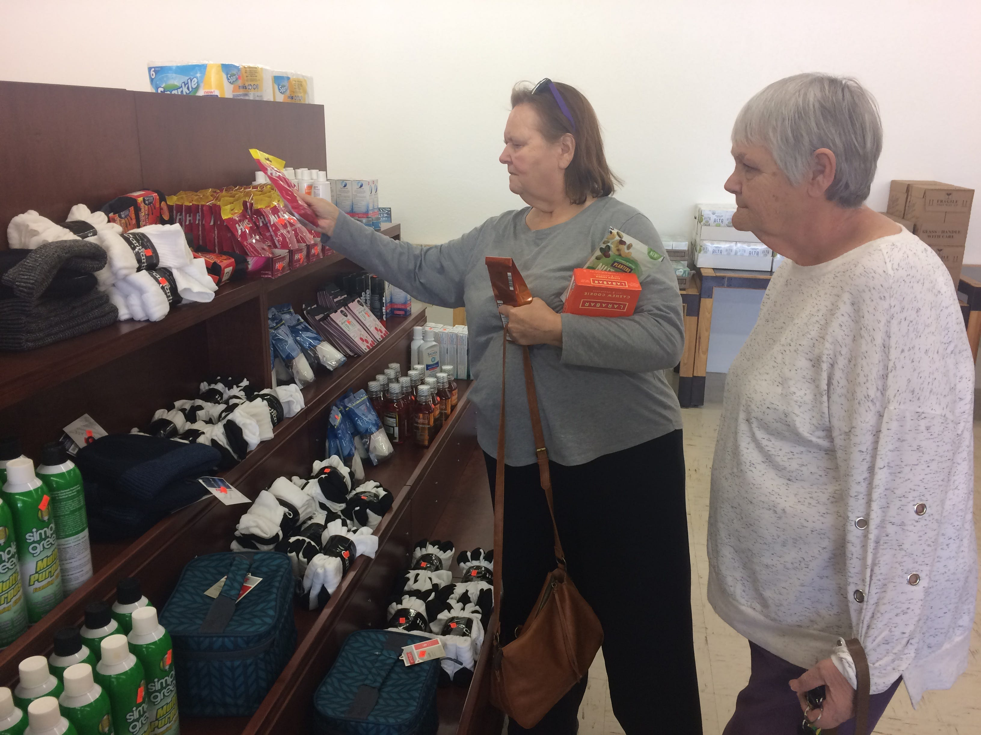 Lynn Williams, left, of Powell and Clinton's Judy Gaines browse the aisles at Naturally a Deal.