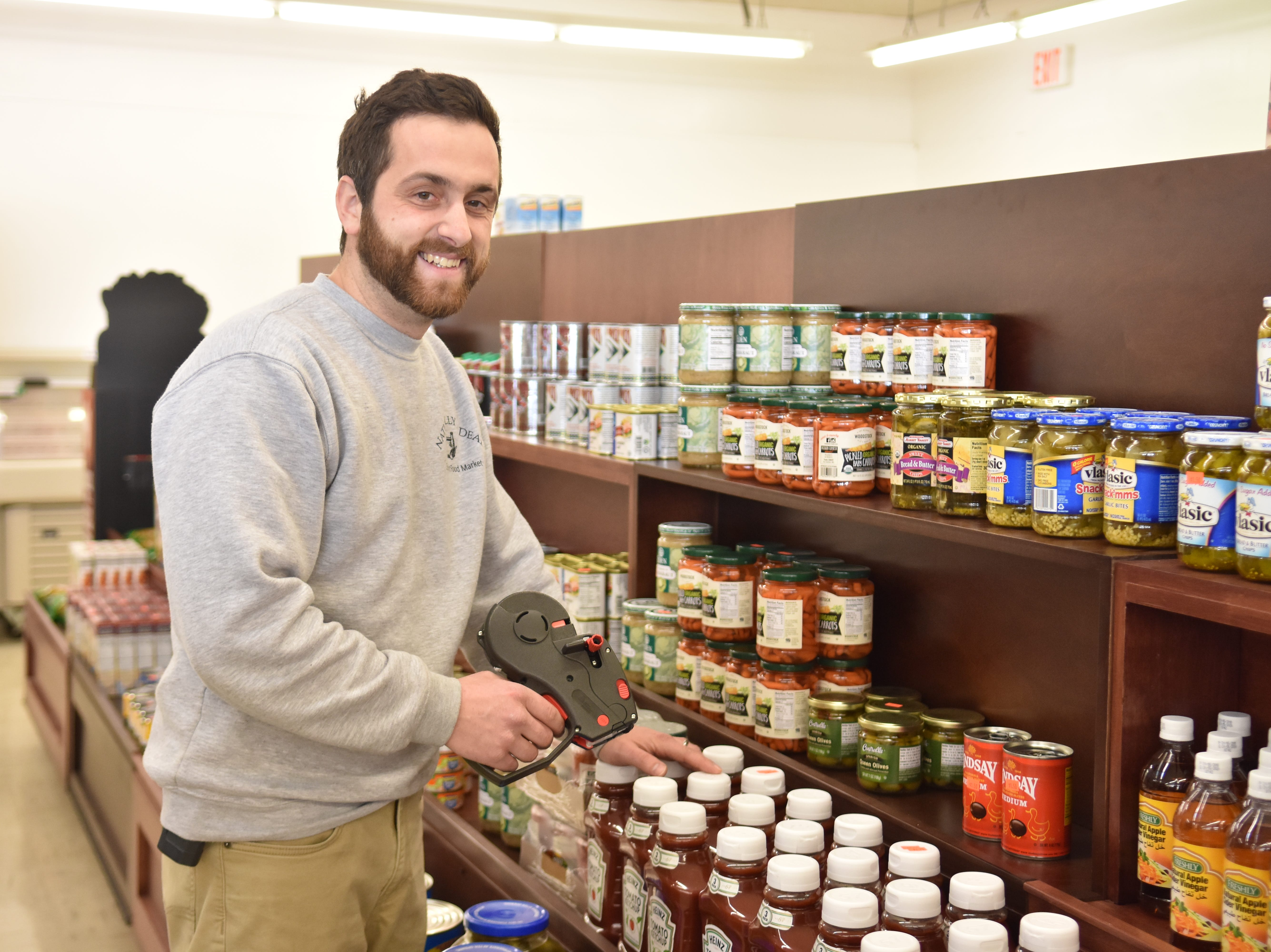 Jon Einwechter, owner of Naturally a Deal, prices food items.
