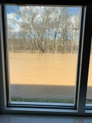 Water levels rose about 20 feet this weekend, engulfing land near a strip of businesses in Hardin Valley. Our Home Real Estate avoided flood damage, though water came close to its building, as seen in this photo take through one of the building's windows.