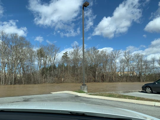 Water takes over a parking lot behind a strip of Hardin Valley businesses.