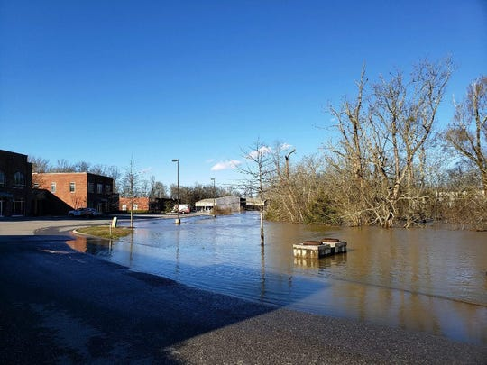 Beaver Creek overflowed in Hardin Valley, burying a parking lot near a strip of businesses, as flooding devastated parts of East Tennessee.