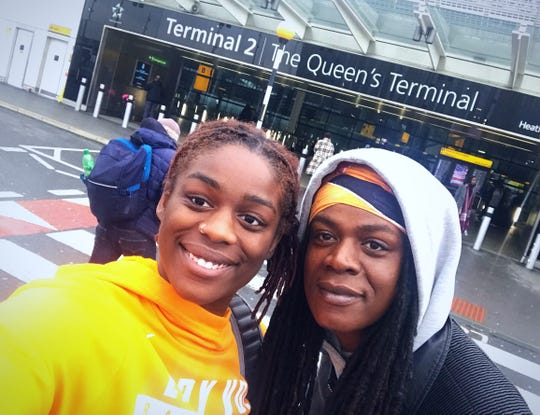Tennessee senior Cheridene Green, left, and her mother, Sylvia, pose for a photo at Heathrow Airport in London.