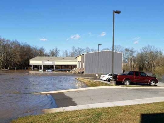 Floodwaters created a lake in a Hardin Valley parking lot but receded within about a day.
