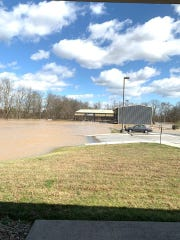 Flooding destroyed a parking lot in Hardin Valley that sits in front of turf fields used by the Knoxville Soccer Academy.