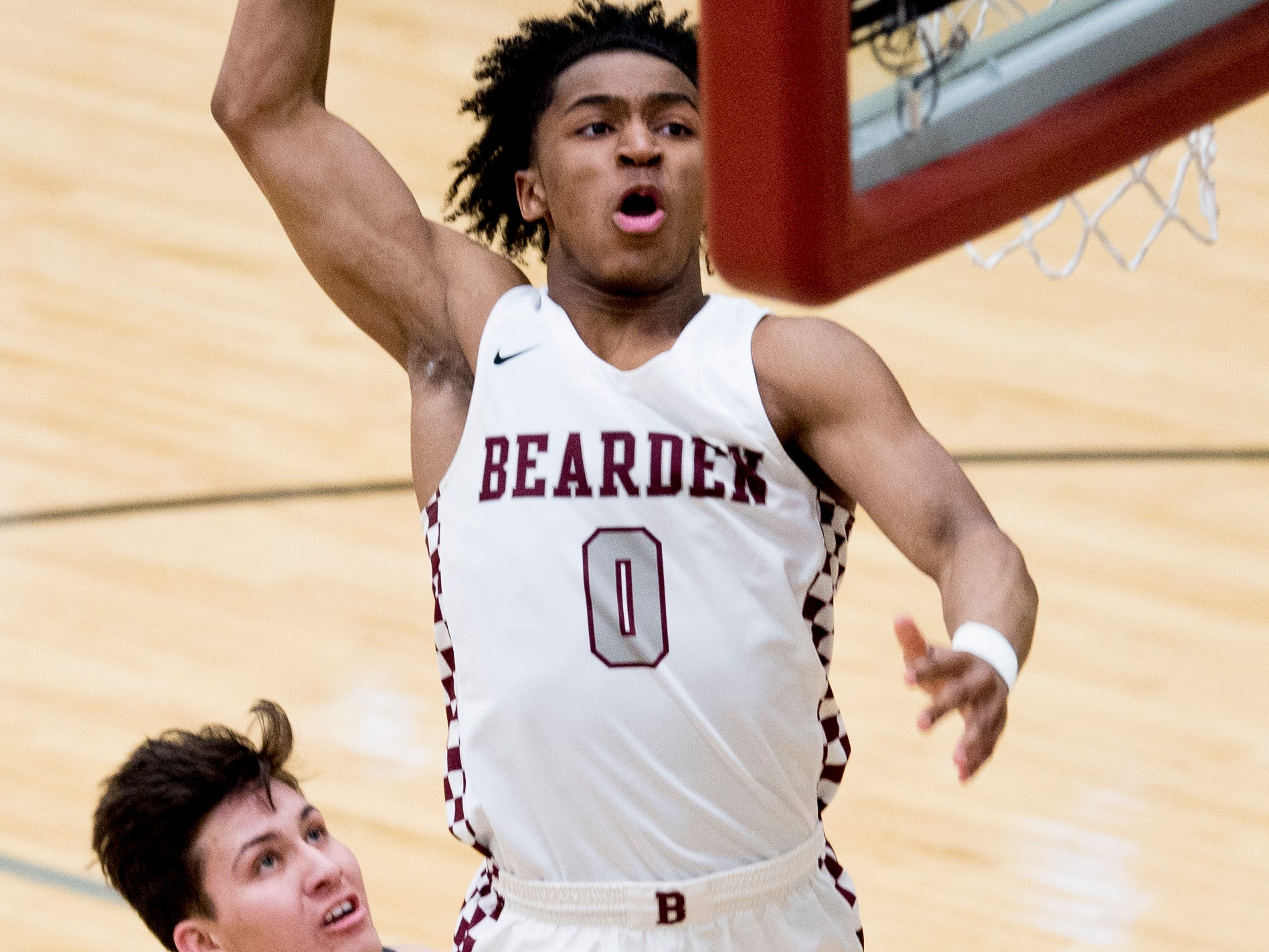 Bearden's Ques Glover (0) dunks during a Region 2-AAA tournament game between Bearden and Maryville at Oak Ridge High School in Oak Ridge, Tennessee on Tuesday, February 26, 2019.