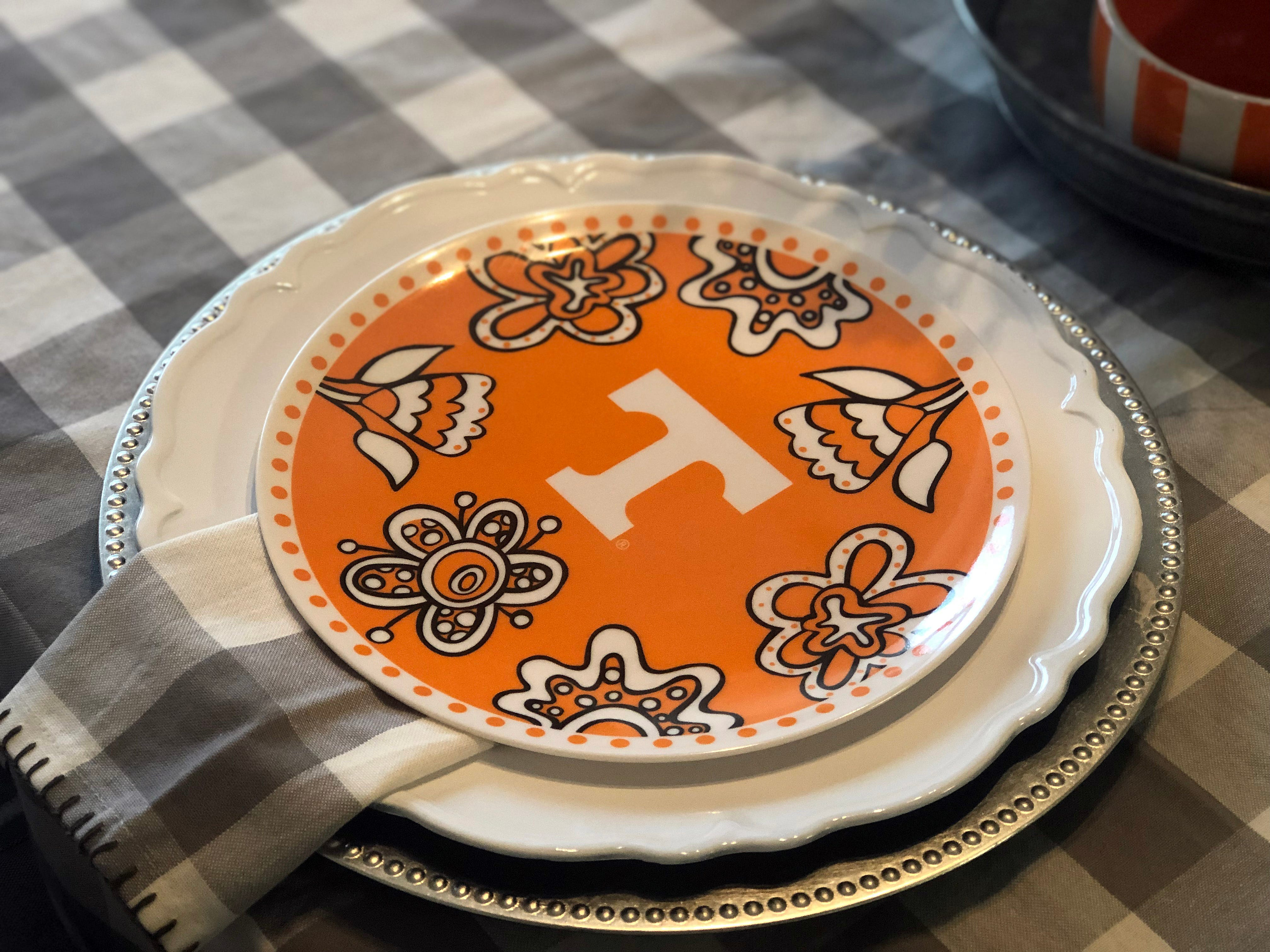 These melamine Tennessee plates by Glory Haus were a great find at Hammer's in Halls several years ago. Layered with plate chargers and a gray gingham table cloth they make a beautiful table setting.