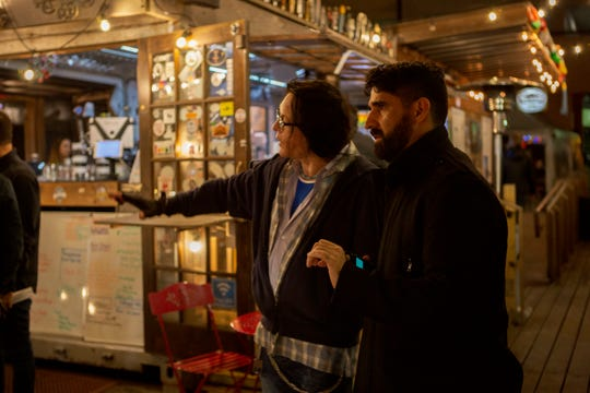"Tommy Wiseau (left) works on the set of ""Big Shark"" in January with Lafayette Native Matt S. Bell, the director of photography for the film. The trailer takes place at The Wurst Biergarten on Jefferson Street."