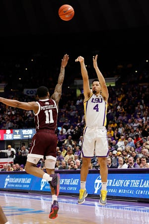 Feb 26, 2019; Baton Rouge, LA, USA;  LSU Tigers guard Skylar Mays (4) shoots the ball over Texas A&M Aggies guard Wendell Mitchell (11) in the second half at Maravich Assembly Center. Mandatory Credit: Stephen Lew-USA TODAY Sports