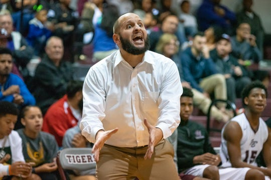 Breaux Bridge's head basketball coach Chad Pourciau calls out his players mistakes from the bench as the Breaux Bridge High Tigers play against the Assumption High Mustangs at home on Tuesday, Feb. 26, 2019.