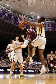 Feb 26, 2019; Baton Rouge, LA, USA; Texas A&M Aggies forward John Walker III (24) grabs a rebound against LSU Tigers forward Emmitt Williams (24) at Maravich Assembly Center. Mandatory Credit: Stephen Lew-USA TODAY Sports