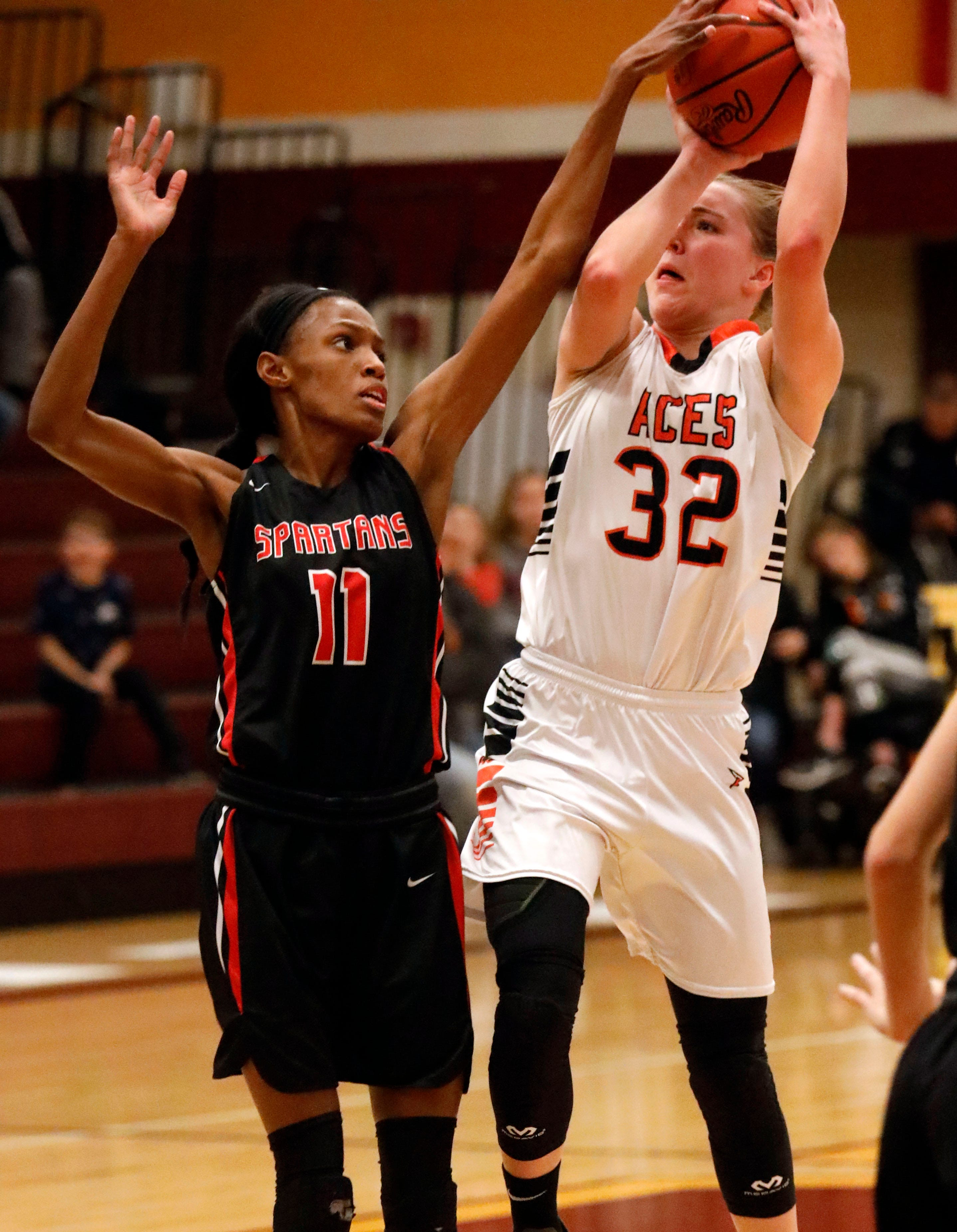 Amanda-Clearcreek's Alyssa Evans tries to shoot over Pleasant's Bekka Twine during Tuesday night's game, Feb. 26, 2019, at Westerville North High School in Westerville. The Aces won the game 41-37.