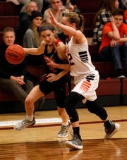 Pleasant's Erika Linder tries to drive past Amanda-Clearcreek's Alyssa Evans during Tuesday night's game, Feb. 26, 2019, at Westerville North High School in Westerville. The Aces won the game 41-37.