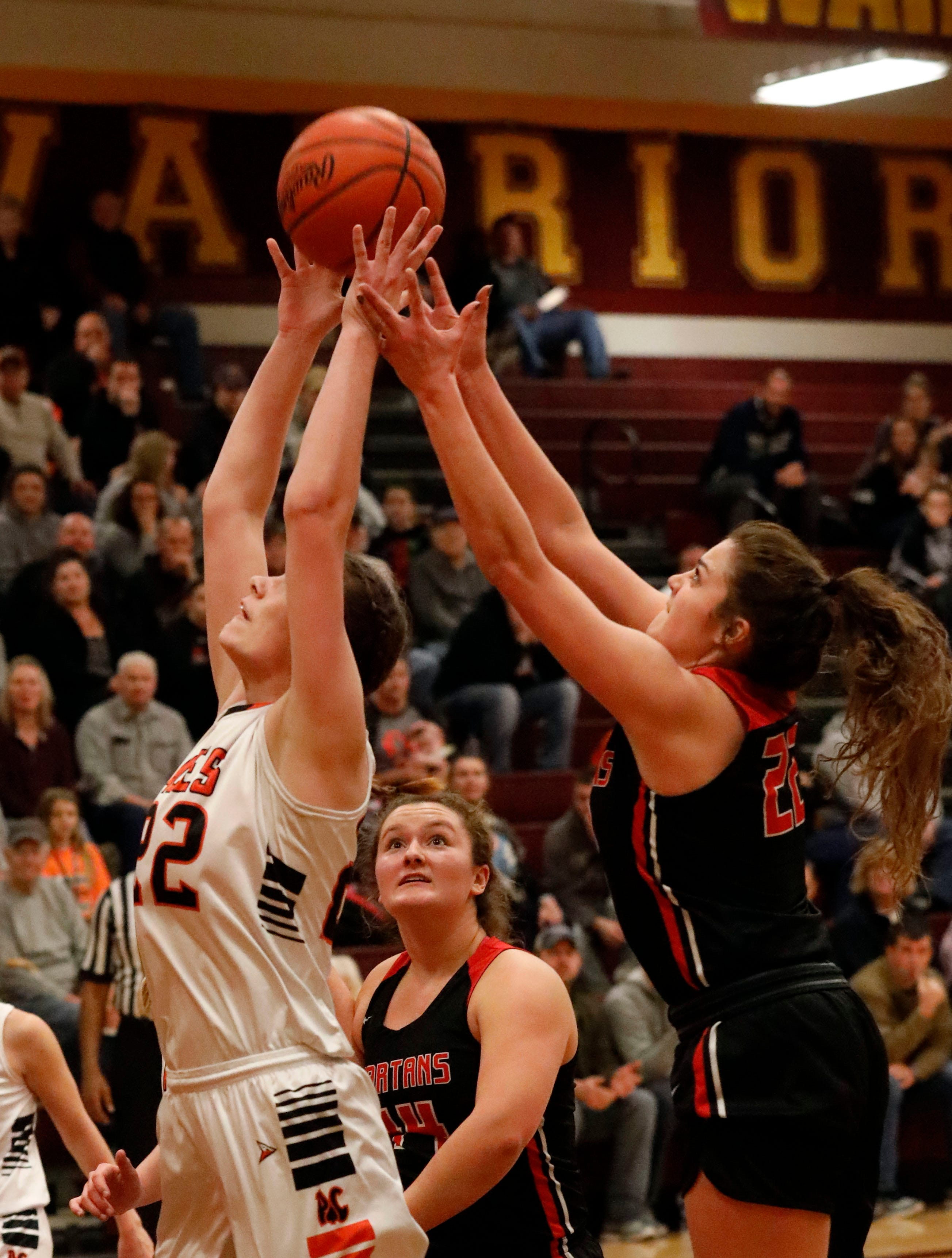 Amanda-Clearcreek's Carlie Craycraft, left, and Pleasant's Katelynn Connell fight for a rebound during Tuesday night's game, Feb. 26, 2019, at Westerville North High School in Westerville. The Aces won the game 41-37.