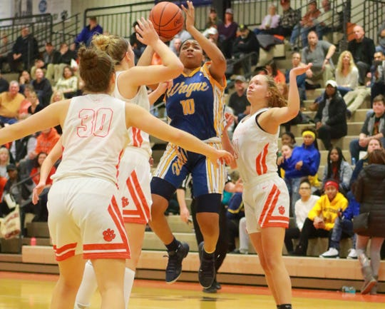Wayne Memorial's Jeanae Terry, who scored 16 points, puts up a shot in a 61-48 victory at Brighton on Tuesday, Feb. 26, 2019.