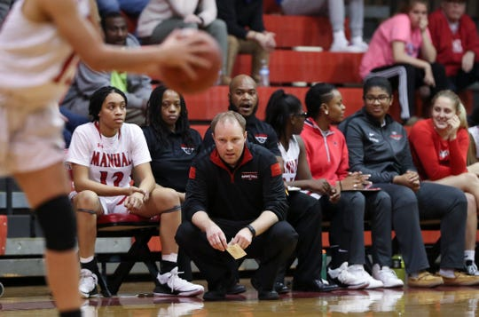 Manual head coach Jeff Sparks watches his team against Assumption during their game at Manual High School.  Feb. 26, 2019