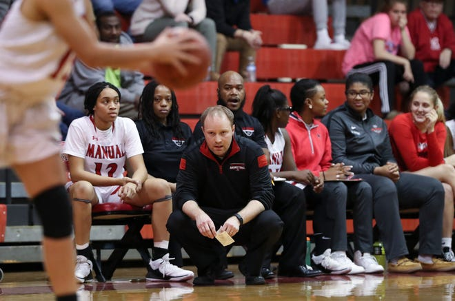 Manual head coach Jeff Sparks watches his team against Assumption during their game at Manual High School.  