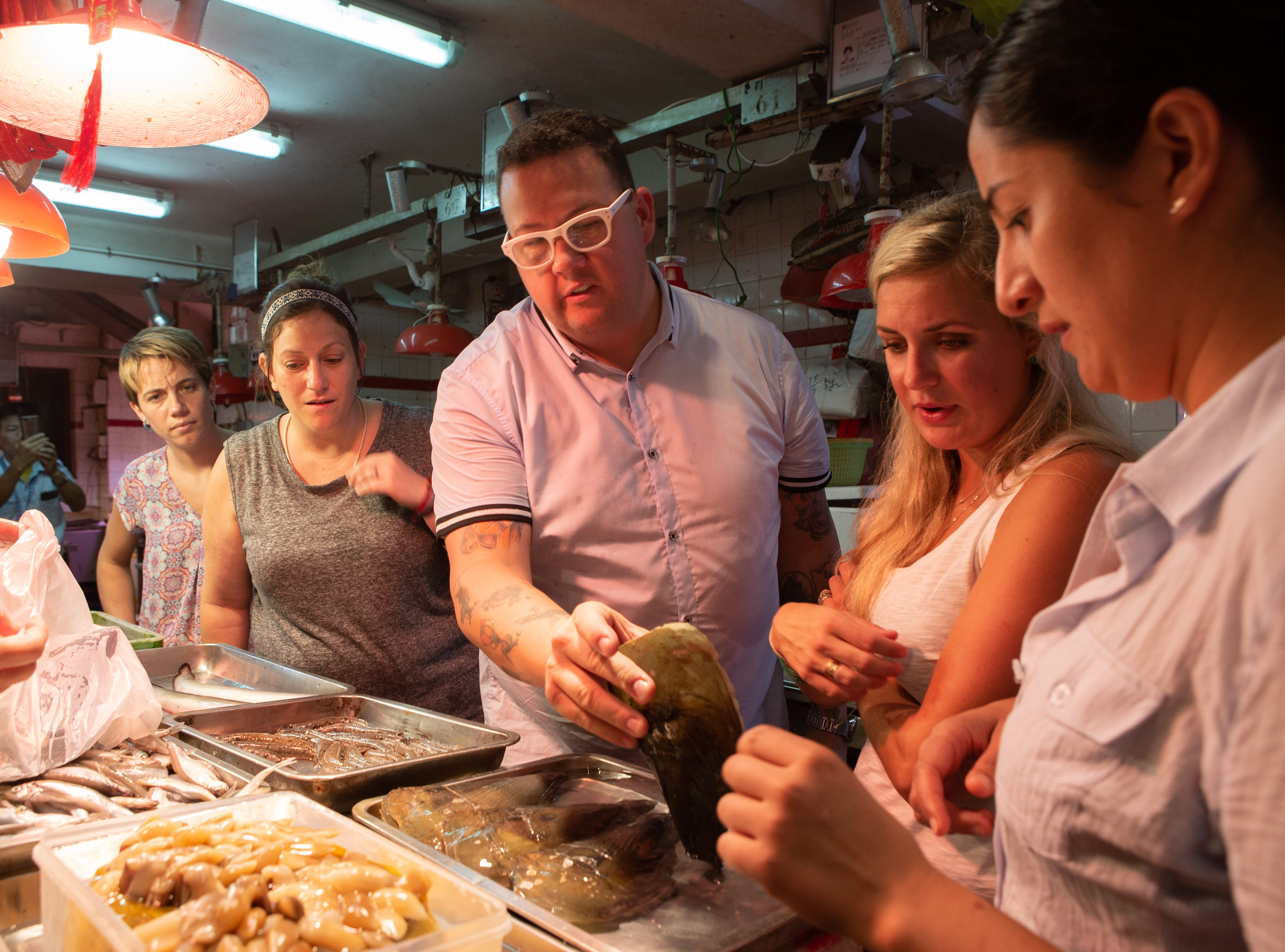 "(From left to right): Adrienne Wright, Sara Bradley, judge Graham Elliot, Kelsey Barnard and Michelle Minori on ""Holy Macau!"" episode 13 of Bravo's 'Top Chef:' Kentucky season."