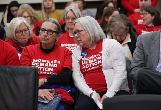 Members of Moms Demand Action protested Kentucky's move to eliminate permits for concealed carry. Ohio lawmakers introduced a similar bill Wednesday.