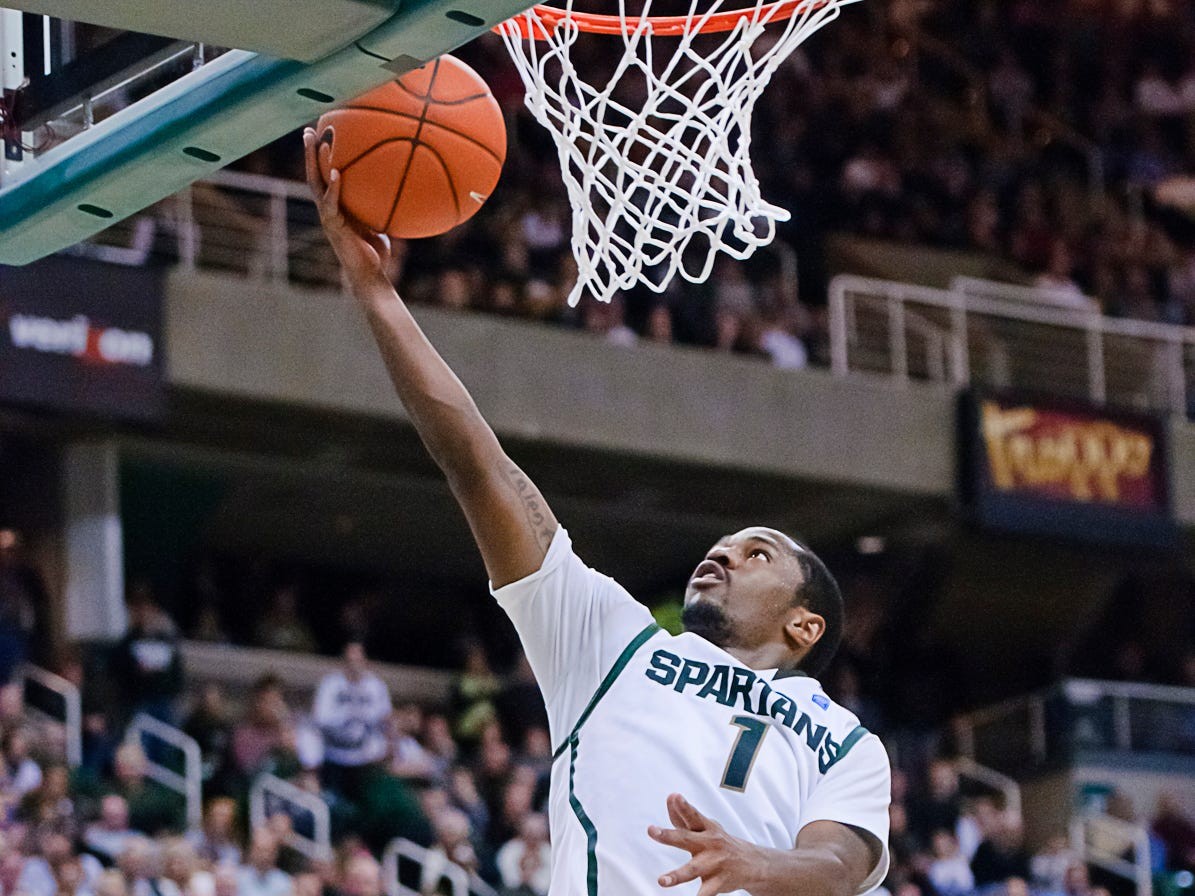 Kalin Lucas drops 2 of his game high 26 points over Will Sheehey (right) of Indiana with 19.8 seconds remaining in the 2nd half of their game Sunday January 30, 2011 in East Lansing.  Lucas' points made the score 79-77 Indiana.