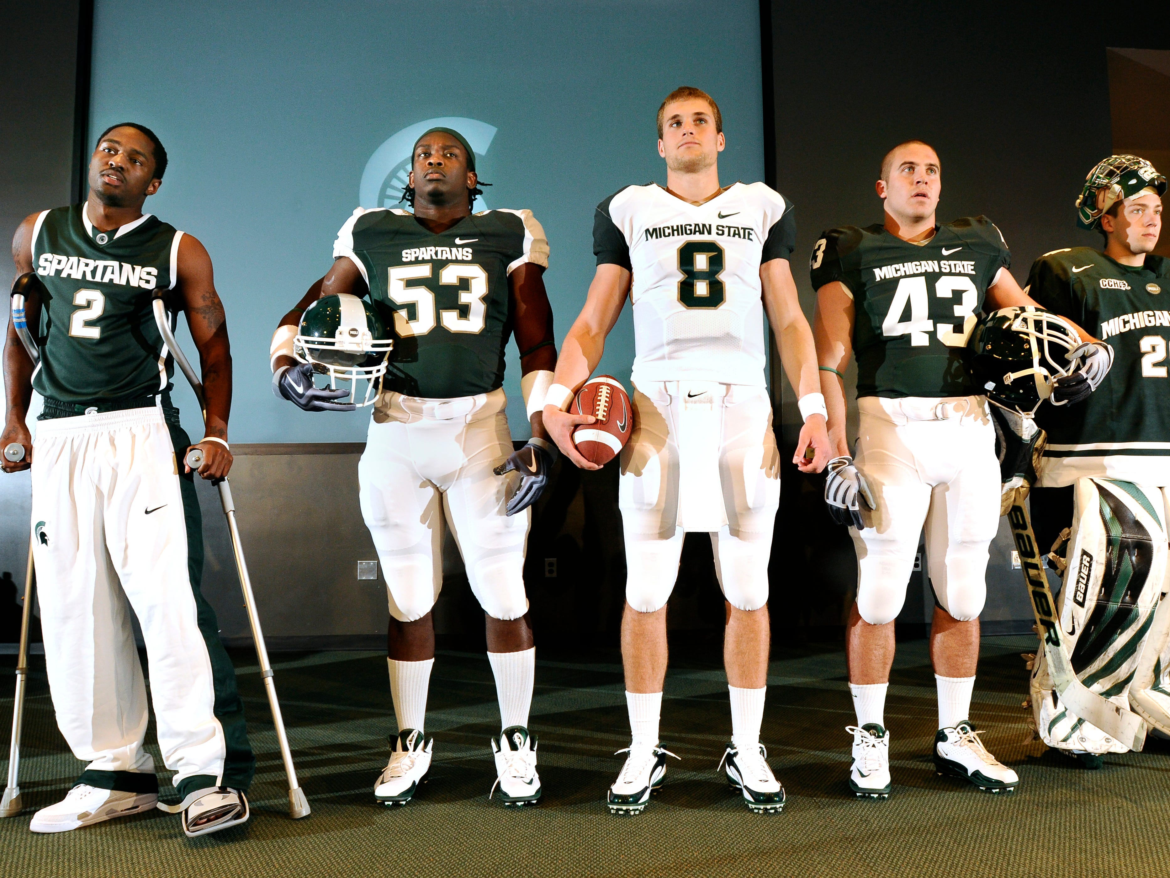 Michigan State athletes Kalin Lucas, Greg Jones, Kirk Cousins, Eric Gordon,  Drew Palmisano, left to right, are among the athletes showing their new uniforms during a news conference unveiling MSU's new branding and Identity Program in East  Lansing Friday 4/23/2010.