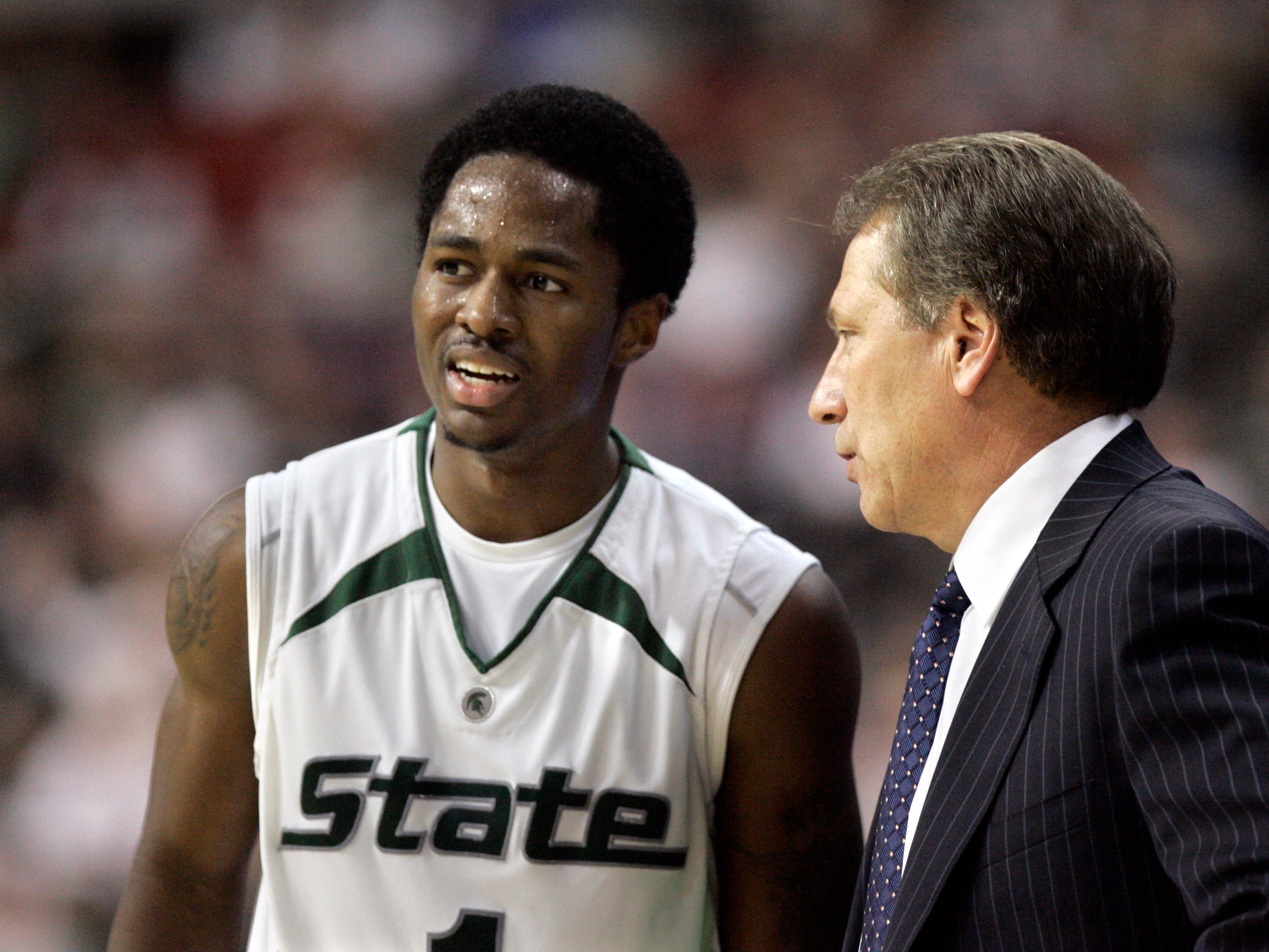 """Michigan State head basketball coach Tom Izzo talks with guard Kalin Lucas during an NCAA basketball game in Auburn Hills, Mich., in this Dec. 22, 2007 photo. Izzo says the point guard is the quickest player he's coached in 13 years as a head coach and 25 seasons on the Spartans' bench. """"It's an honor to hear him say that, especially at a program like this,"""" Lucas said Sunday, Jan. 27, 2008."""