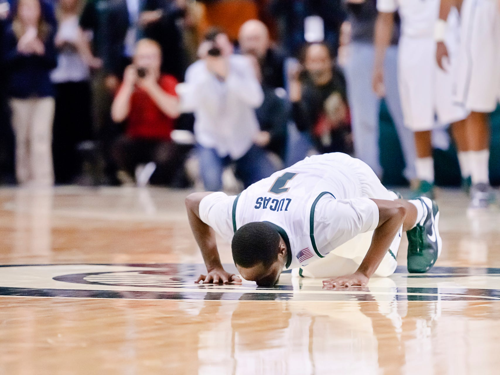 Kalin Lucas of MSU kisses the Sparty logo as he checks out of the Spartans' game with Iowa Wednesday March 2, 2011 on Senior Night in East Lansing.