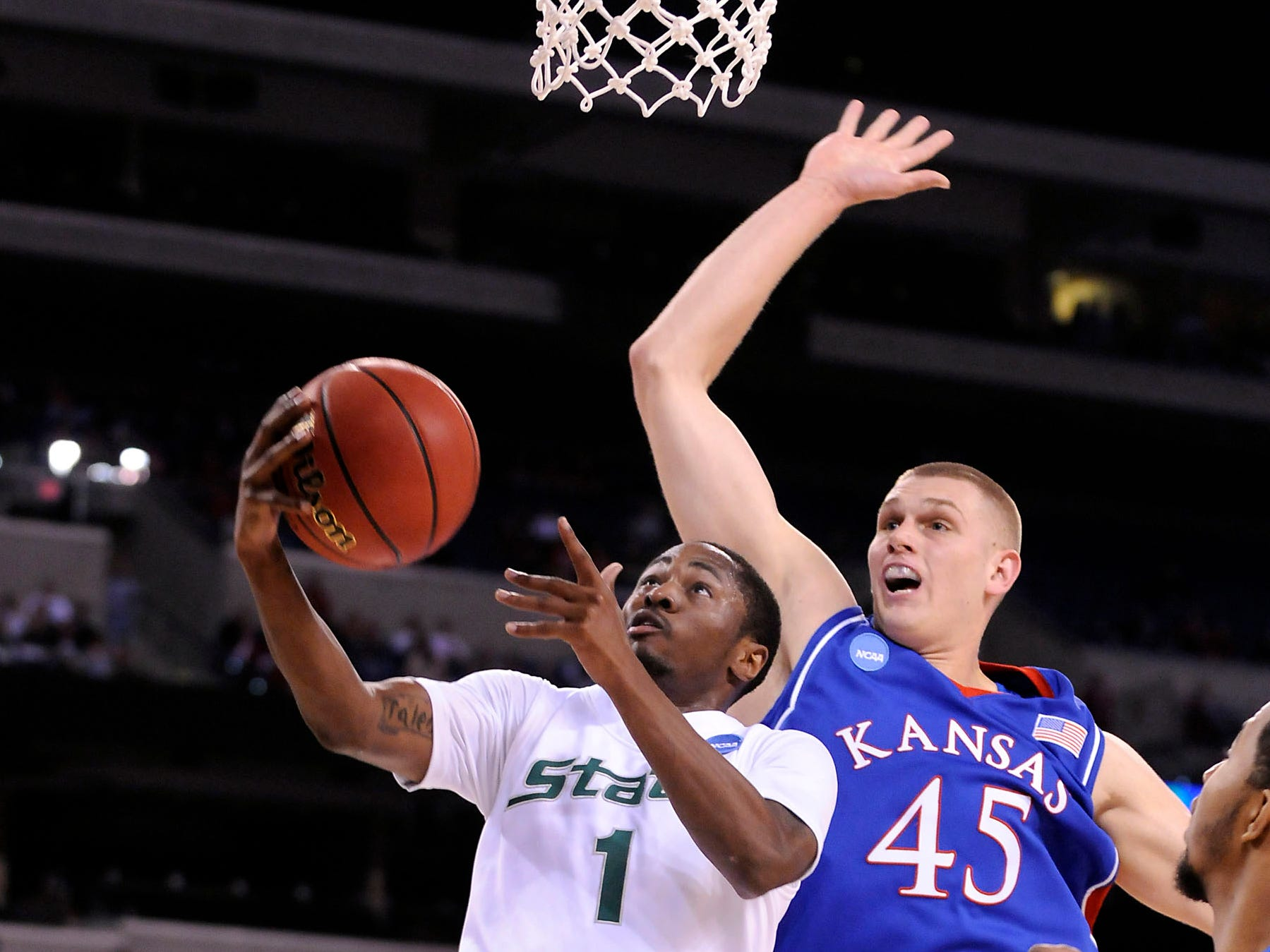 Michigan State's Kalin Lucas gets past Kansas's Cole Aldrich for a score in their  NCAA tournament Friday, March 27 in Indianapolis.