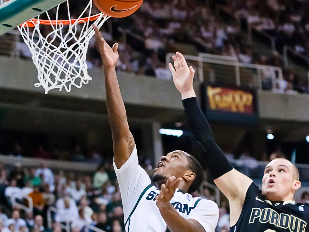 Kalin Lucas (left) of MSU lays the ball in while being defended by D.J. Byrd of Purdue during their game Sunday February 27, 2011 in East Lansing.  Lucas was the only bright spot for MSU in the game as he contributed a game-high 23 points.