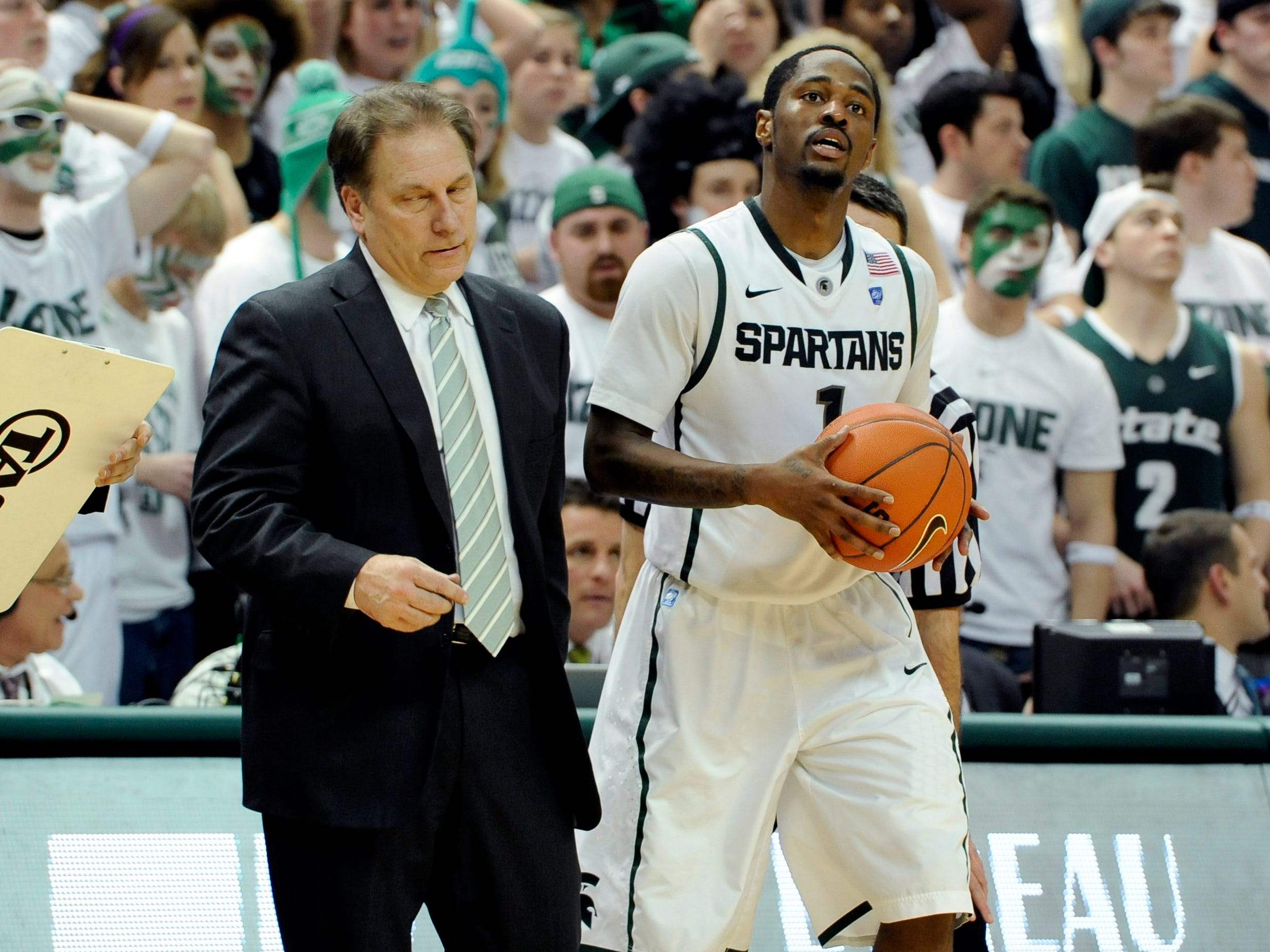 MSU head coach Tom Izzo and guard Kalin Lucas look on near the end  of the Spartans' 57-61 loss to Michigan Thursday, Jan.27, 2010.
