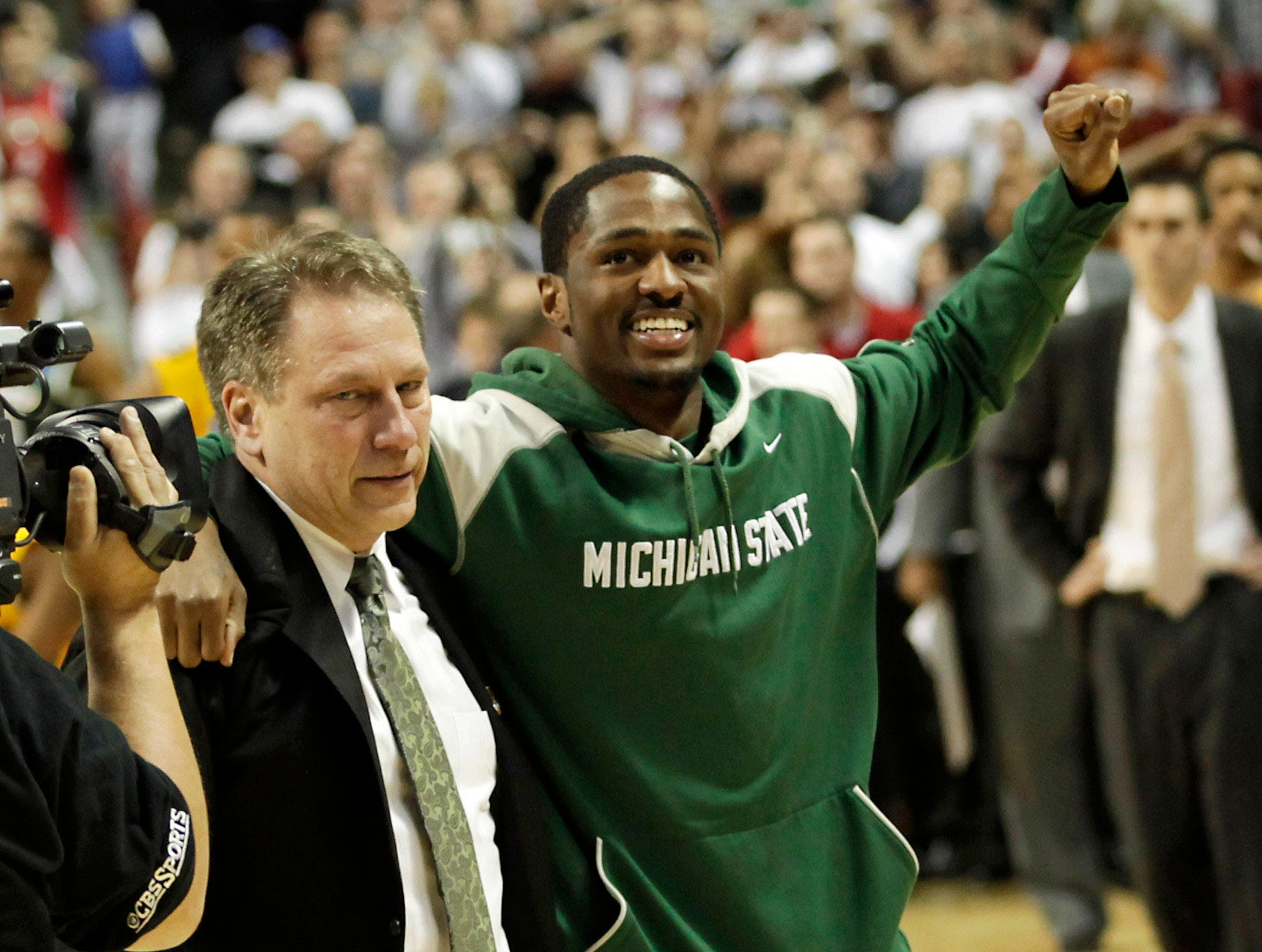 Injured Michigan State player Kalin Lucas, right, celebrates with Michigan State head coach Tom Izzo after Michigan State beat Maryland 85-83 in an NCAA second-round college basketball game in Spokane, Wash., Sunday, March 21, 2010. Lucas went down in the first half with an ankle injury.