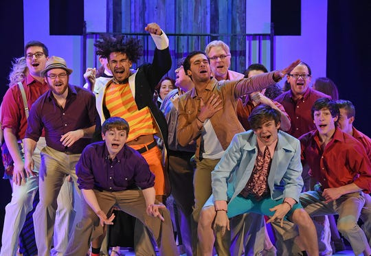 "The cast of ""Mamma Mia!"" performs a scene Tuesday night at the Renaissance Theatre."