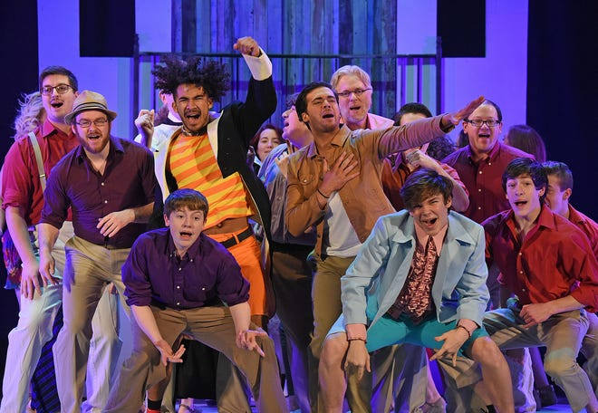 """The cast of """"Mamma Mia!"""" performs a scene Tuesday night at the Renaissance Theatre."""