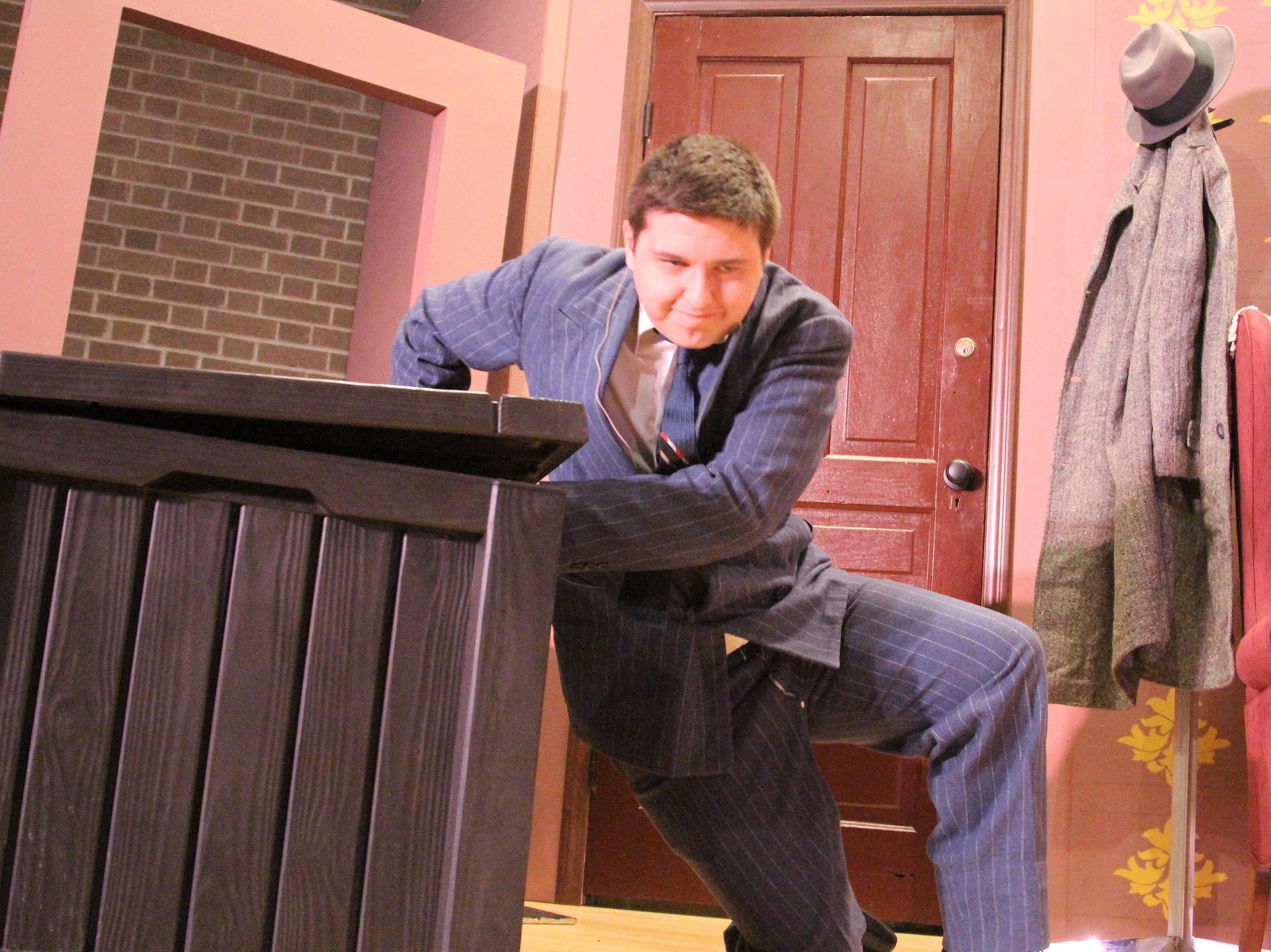 Mortimer Brewster, played by OSU Marion student Darren Sites, collapses at his family's home after discovering a sinister secret.