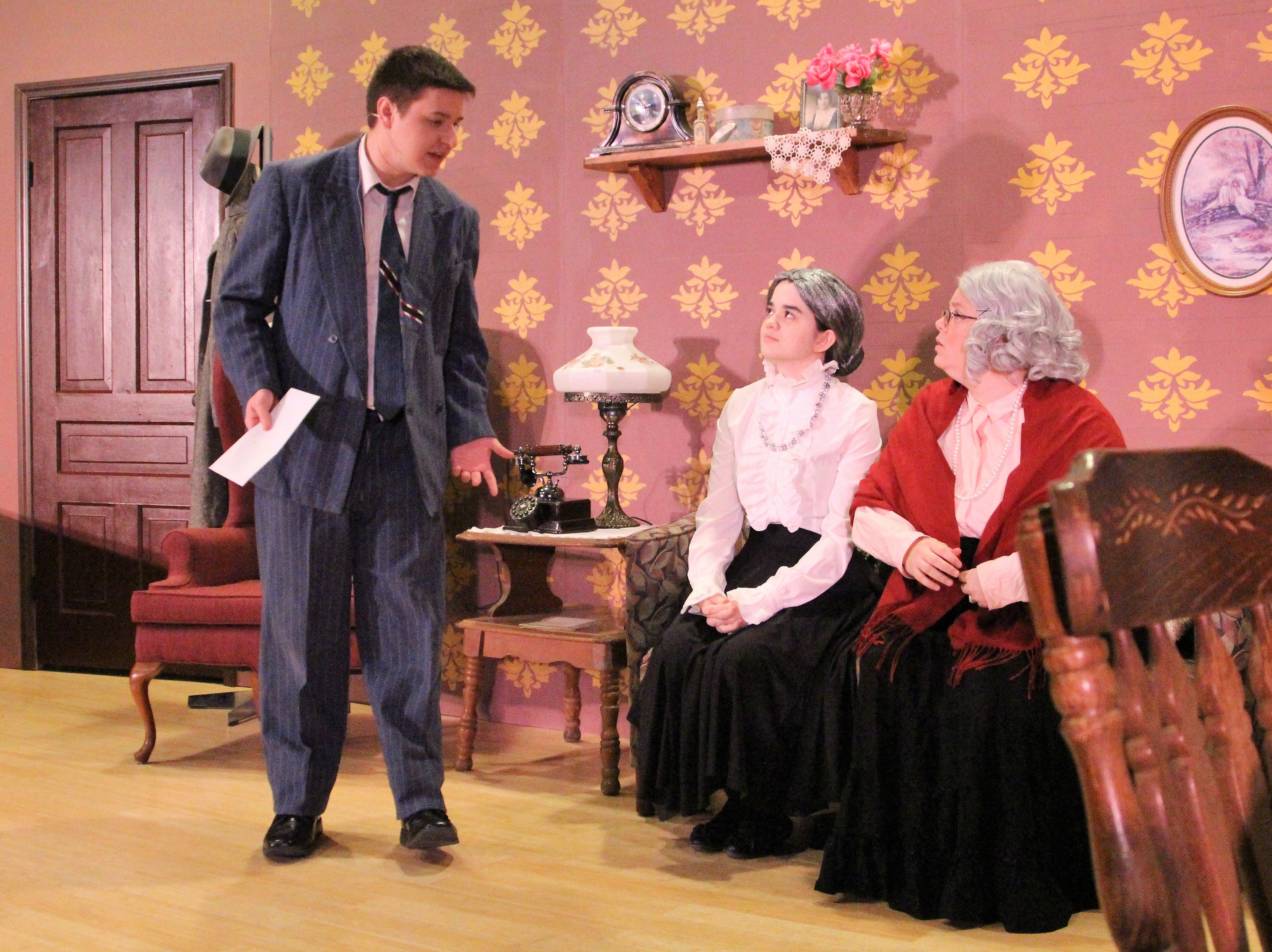 """Lead Mortimer Brewster, played by Darren Sites talks to his two aging aunts while debating whether to go through with his recent promise to marry the woman he loves. The student-led production of """"Arsenic & Old Lace"""" is part of an effort by the college's office of student life to bring more plays to the campus's stage."""