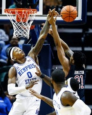 Memphis defender Kyvon Davenport (left) knocks a rebound away from Temple forward Justyn Hamilton (right) during action at the FedExForum, Tuesday, February 26, 2019.