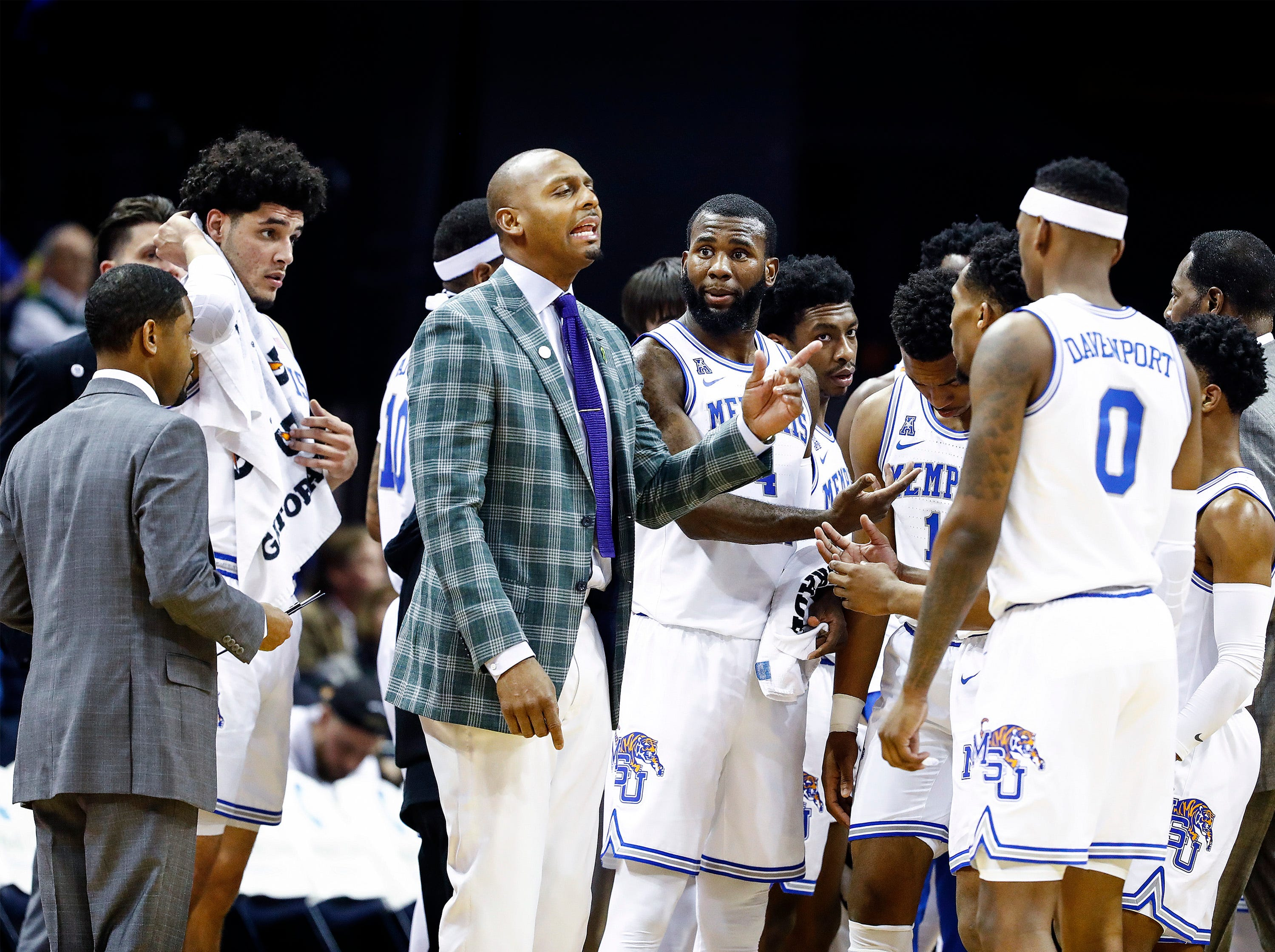 Memphis head coach Penny Hardaway (left) directs his players during break in action against Temple at the FedExForum, Tuesday, February 26, 2019.