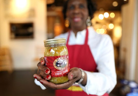 Beverly Walker holds a jar of her homemade Lil' Bit of Country brand hot chow chow, made with brined onions, vinegar, peppers, celery, cabbage and tomatoes at Palladio Antique Store Cafe on Friday, Feb. 22, 2019.